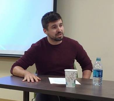 "Kyle Pruitt delivering his paper ""Reconfiguring the Public Sphere: The Labor Movement, Civil Society, and the Stae from 1870s to the New Deal"""