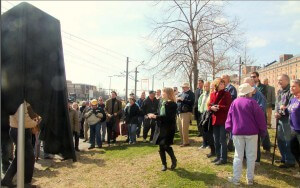Labor history supporters gather before the unveiling of the monument