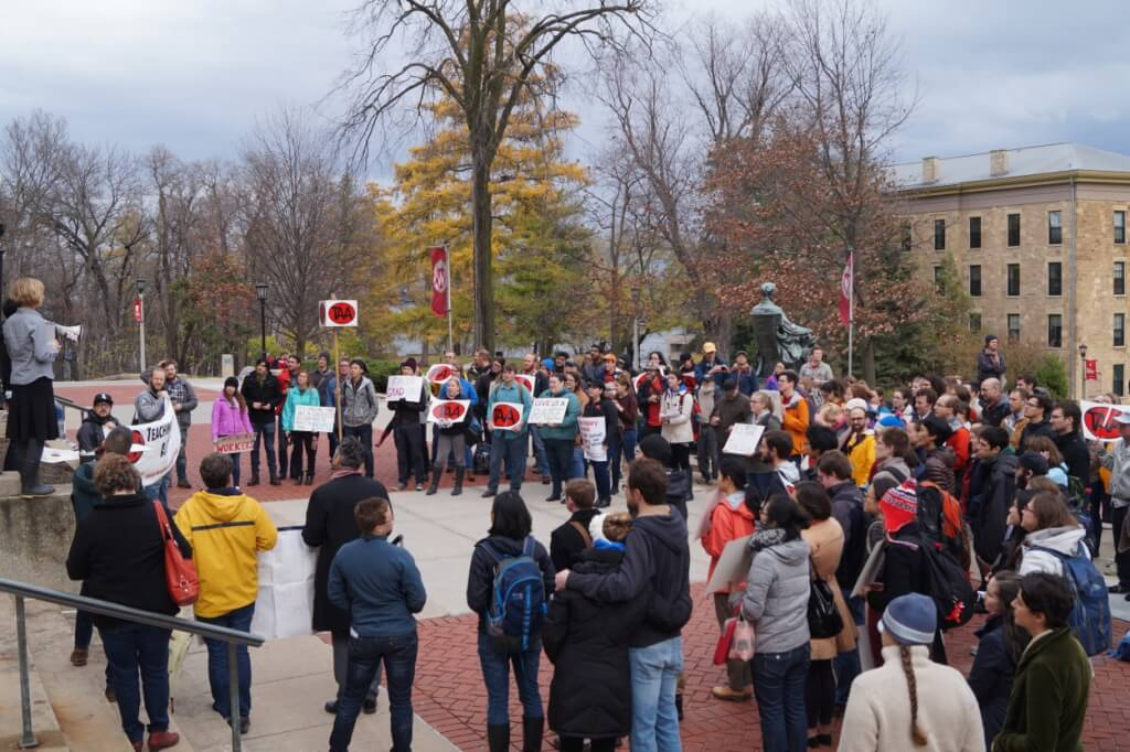 TAA members gathered in front of Bascom Hill, protesting the new proposal to restructure Graduate Assistant pay at UW-Madison. Photo credit to Cullen Vens, TAA Stewards' Council Co-Chair and Graduate student in Botany at UW-Madison.