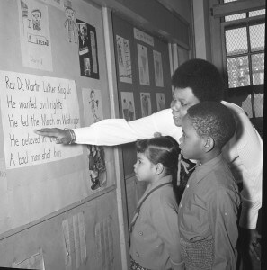 Paraprofessional Doris Hunter teaches about the life of Dr. Martin Luther King, Jr. at PS 25 in Brooklyn in 1970. Many paraprofessionals took the lead in bringing African-American, Latino, and Asian-American history and culture into public schools in New York City. United Federation of Teachers. Credit: Hans Weissenstein Negatives Collection, Tamiment Library and Robert F. Wagner Labor Archives, NYU.