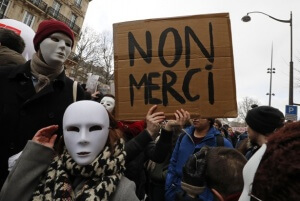 """French sudents and labour union workers attend a demonstration against the French labour law proposal in Paris, France, as part of a nationwide labor reform protest, March 9, 2016. The slogan reads """"No thanks"""".     REUTERS/Philippe Wojazer  - Credit: Slate"""