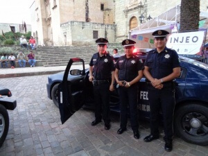 Federal police attempt public relations effort at a street fair in Oaxaca City. August 2015. Credit: Eric Larson.