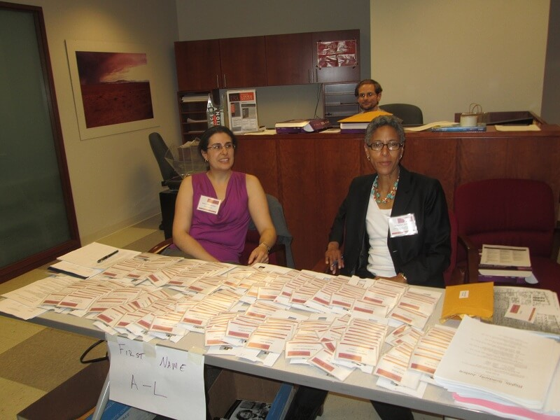 Registration desk at 25 Broadway during the 2013 LAWCHA Conference. Donna Haverty-Stacke and Kimberly Phillips in front, Ryan M. Poe in the back.