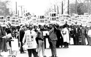 Striking members of Memphis Local 1733 hold signs whose slogan symbolized the sanitation workers' campaign in 1968. 1968. Source: Walter Reuther Library.