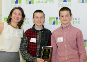 Colton Jenkins and Anthony Paul, winners of this year's National History Day in Maryland (shown with Phoebe Stein, of the Maryland Humanities Council).
